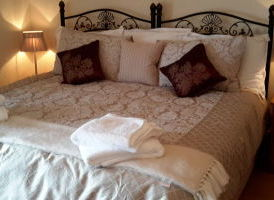 Bedroom 1 - Singles become sumptuous superking at Warrandyte Cottage